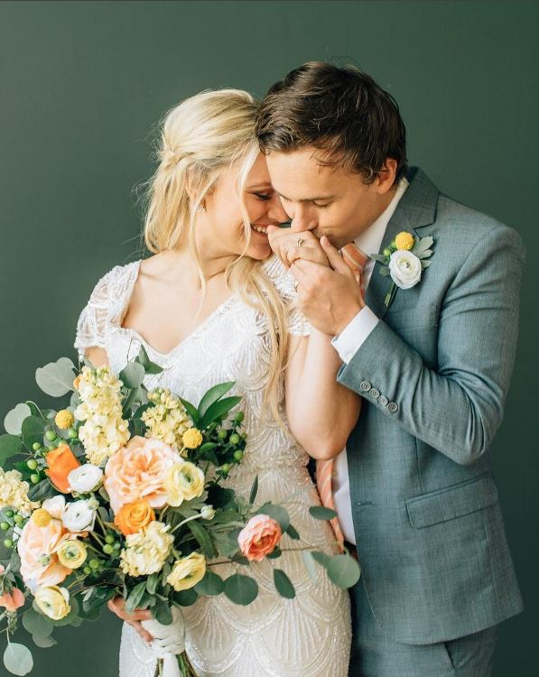 Utah-Wedding-Custom-Made-Suits-Jack-Suits-bride-and-groom-with-bouquet
